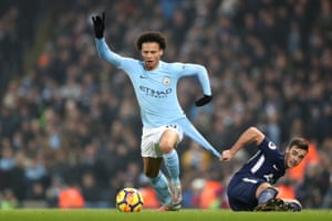 Leroy Sane of Manchester City is held back by by Harry Winks of Tottenham during City's 4-1 win at the Etihad stadium.