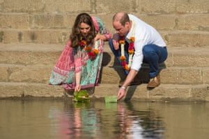William and Kate place flower petals in the water of the Banganga water tank
