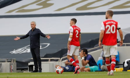 José Mourinho watches on from the sidelines during the north London derby.