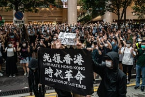People hold up a banner during a protest in Hong Kong
