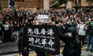 Demonstrators take part in a protest against the new national security law on July 1, 2020 in Hong Kong