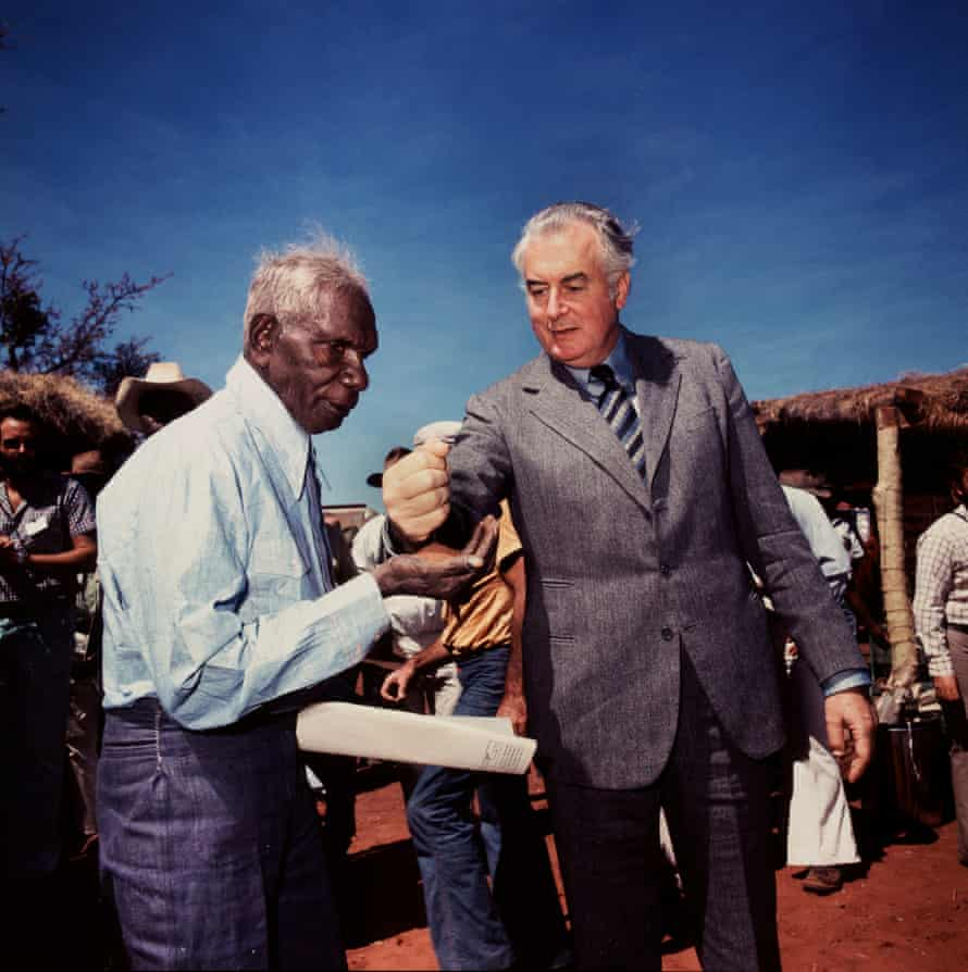 Prime minister Gough Whitlam pours soil into the hands of traditional land owner Vincent Lingiari, Northern Territory 1975.