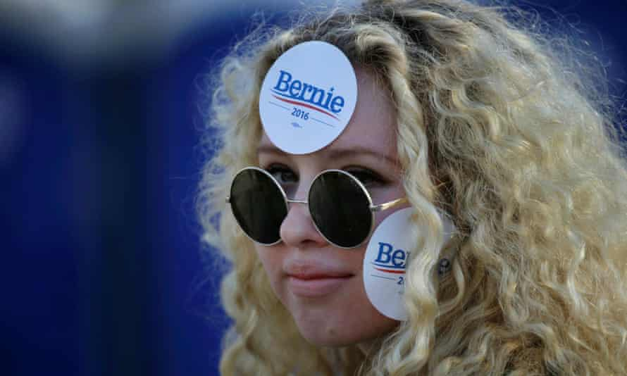 A Bernie Sanders supporter wears campaign stickers at the rally in Greenwich Village.