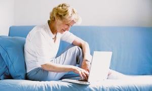 An older woman uses a laptop