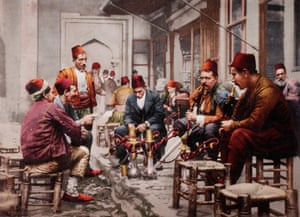 Water pipe smokers in front of a coffee house in Istanbul, Turkey. 1897