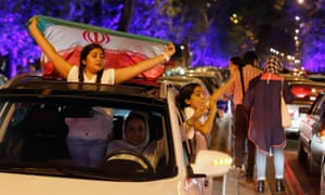 Iranians take to the streets to celebrate the nuclear deal.