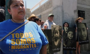 Activists in Ciudad Juarez, Mexico, on Thursday, carrying photographs of migrant children who have died trying to cross the US border with Mexico