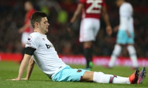 Cresswell lies injured.