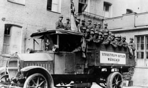 Hitler's stormtroopers in the back of a truck before the Munich Putsch.