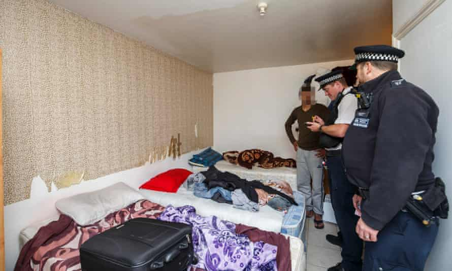 Newham council officials and police inspect an overcrowded property.