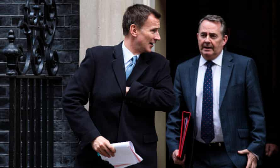 Cabinet members Jeremy Hunt and Liam Fox leave Downing Street.