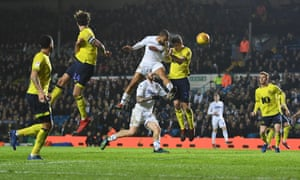 Kemar Roofe heads home Leeds United's injury time winner.