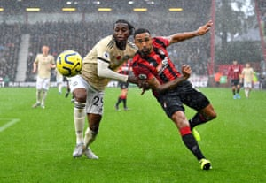 Bournemouth's Callum Wilson tussle at a wet Vitality Stadium.