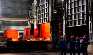 Workers at a steel plant in Zouping, eastern China. A trade war with the US will benefit no one, Beijing has warned.
