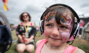 Ellie Woods, 5, watches Charli XCX on The Other Stage with her parents