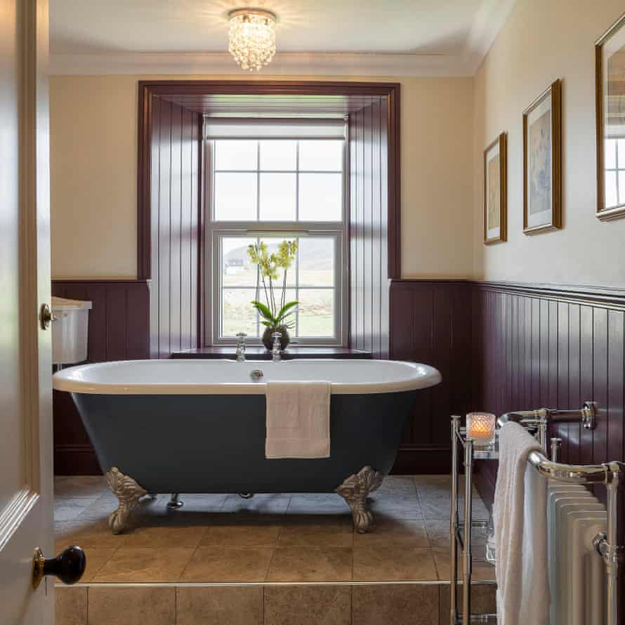 Bathroom of deluxe room at Smoo Lodge, Durness, Sutherland, UK