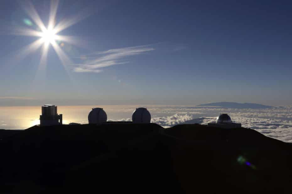 The sun sets behind telescopes at the summit of Mauna Kea in Hawaii.
