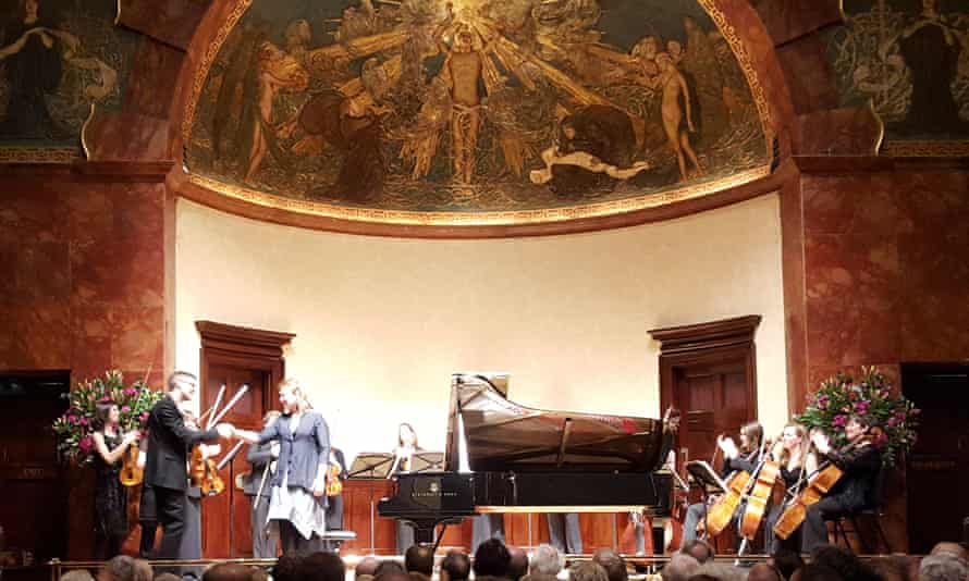 Squeezing 14 players and a grand piano on the Wigmore stage is no mean feat … Scottish Ensemble with Gabriela Montero.