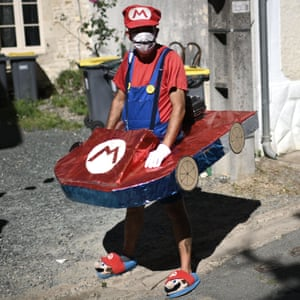 A spectator clothed as Super Mario waits for the riders during the 11th stage between Chatelaillon Plage and Poitier.