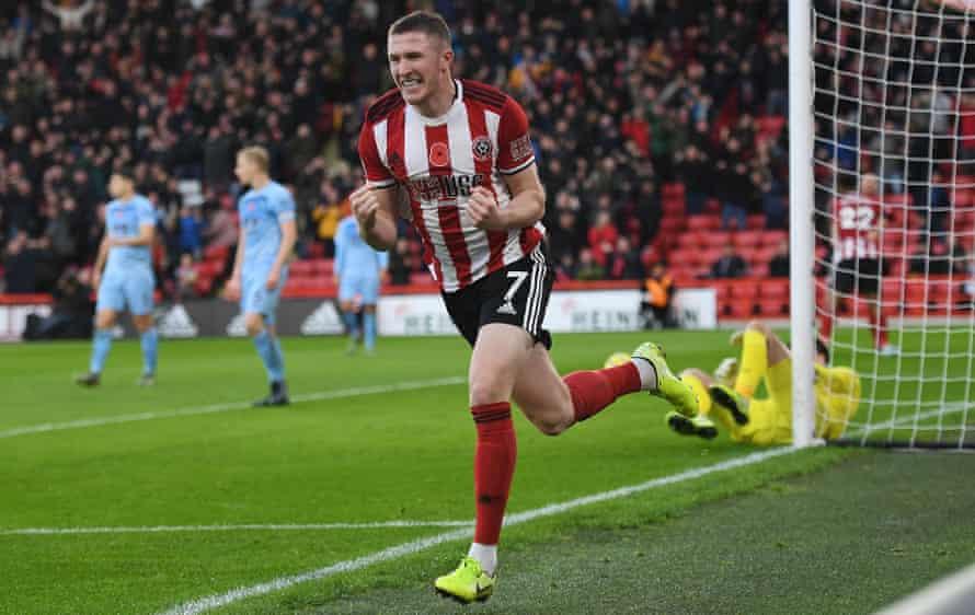 John Lundstram celebrates scoring his second goal for Sheffield United against Burnley.