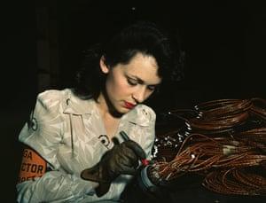 An aircraft mechanic checks electrical assemblies at the Vega Aircraft Corporation, California, 1942.