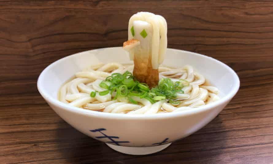 A noodle Amabie mascot created from chikuwa (tubular fish 'sausage') rising from a bowl of udon noodles.