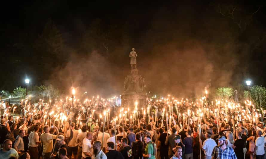 White nationalists march on the grounds of the University of Virginia ahead of the Unite the Right rally in Charlottesville, on 11 August 2017.