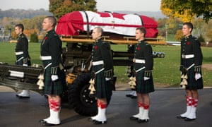 The casket of Cpl. Nathan Cirillo is towed during his funeral procession in Hamilton, Ontario