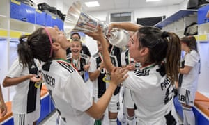 Juventus's Barbara Bonansea (left) takes a drink from the Women's Coppa Italia after Juve's victory in April