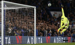 Thibaut Courtois is unable to stop Jordan Henderson's shot from giving Liverpool a 2-1 win at Chelsea.