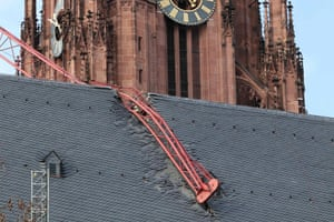 A crane collapses across the roof of a cathedral in Frankfurt am Main, western Germany