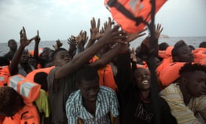 Migrants rescued off the coast of Libya on 4 October