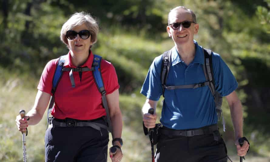 Theresa and Philip May walking in Swiss Alps
