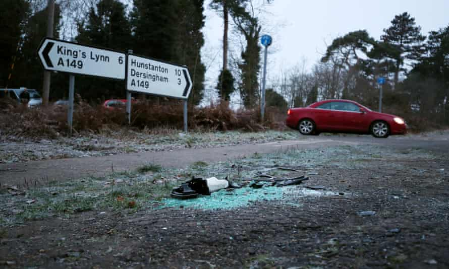 Debris and broken glass at the scene of the accident