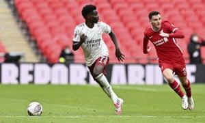Bukayo Saka bursts away from Liverpool's Andrew Robertson during the Community Shield at Wembley on Saturday.