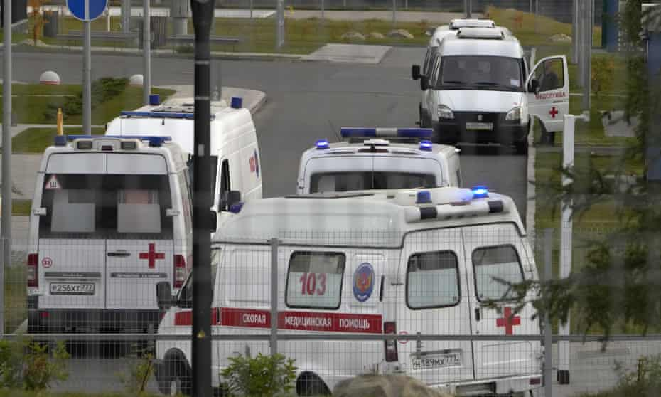 Ambulances wait to deliver patients suspected of having coronavirus to a hospital in Kommunarka, outside Moscow.