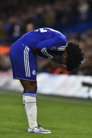 Chelsea's Willian holds his face after clashing with Maxi Pereira.