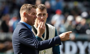 Shane Warne, pictured with Marnus Labuschagne, has called on cricket to do more to address the threats to the sport posed by flooding and rising temperatures.