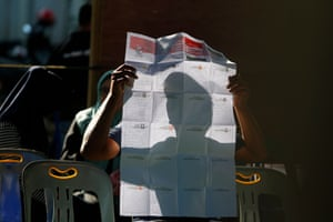 An Indonesia man views a ballot paper before casting his ballot.
