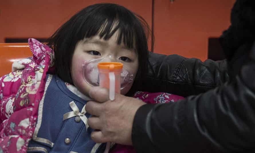 A girl is given oxygen in a respiratory treatment room of a local hospital during heavy smog in Beijing.