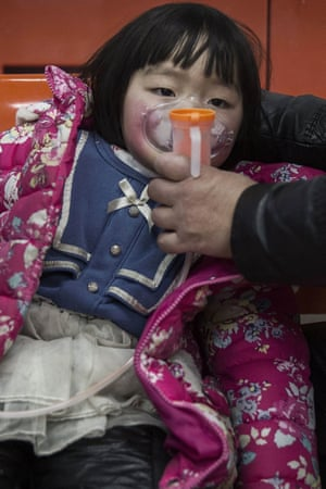 A Chinese girl is given oxygen in a local hospital