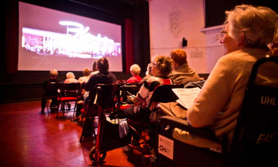 Cinemagoers attend a dementia-friendly film screening at the Barry Memo arts centre in Wales.
