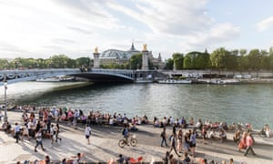 Pedestrians on the banks of the Seine in Paris.