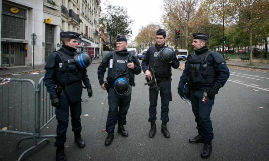 Police officers near the scene of the Bataclan theatre in Paris