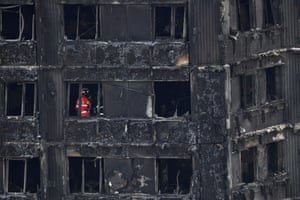 London, UK: Emergency workers continue their work inside the remains of Grenfell Tower