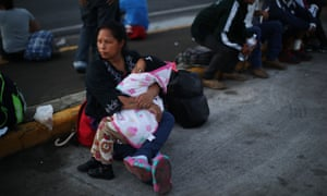 Members of the Central American migrant caravan rest during the trek across Mexico.