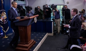 Barack Obama takes questions at the year-end press conference at the White House in Washington.