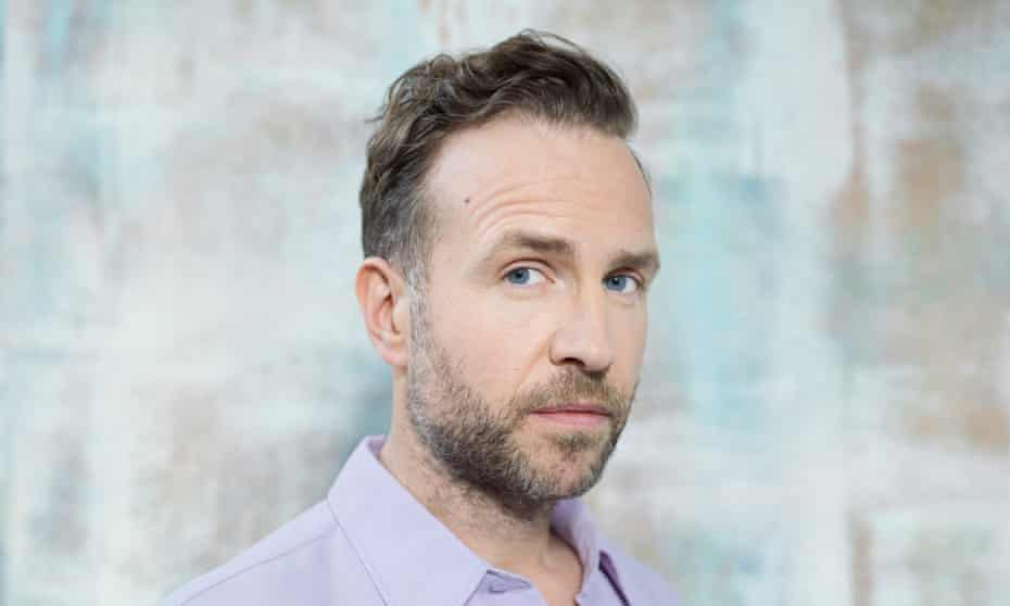 'I try to be nice. Well behaved. I try not to get carried away': Rafe Spall wears lilac shirt by amiparis.com.