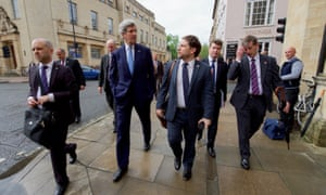 John Kerry walks down a street in Oxford during this week's UK visit