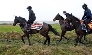 Altior and Nico De Boinville (left) on the Lambourn gallops for trainer Nicky Henderson last month.